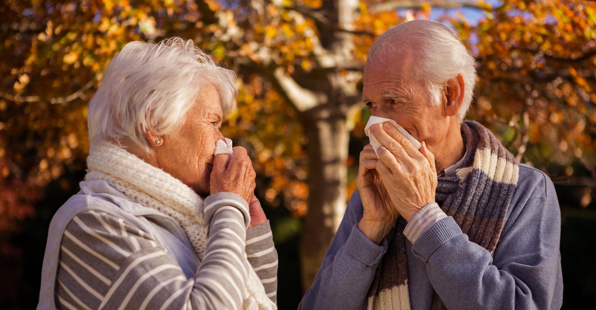 Eldery couple sneezing