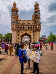 138207063 hyderabad india june 17 2019 the charminar symbol of hyderabad street vendors selling female accesso