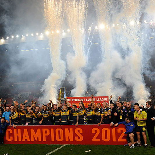 A photo of Leeds players celebrating as they lift the trophy at Old Trafford football stadium, Manchester, after the Rugby League Super League Final 2012