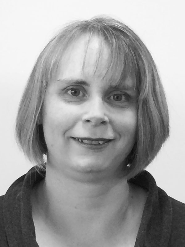 A black and white photo of Dianne Kirk of Red Sky at Night Events