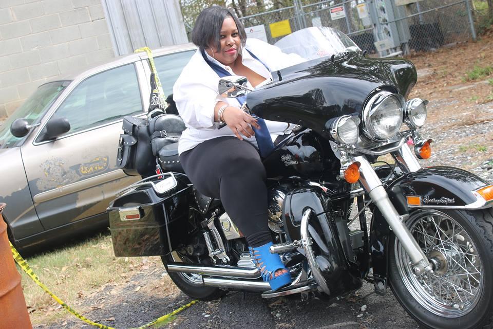 take a model CAROL ON MOTORCYCLE