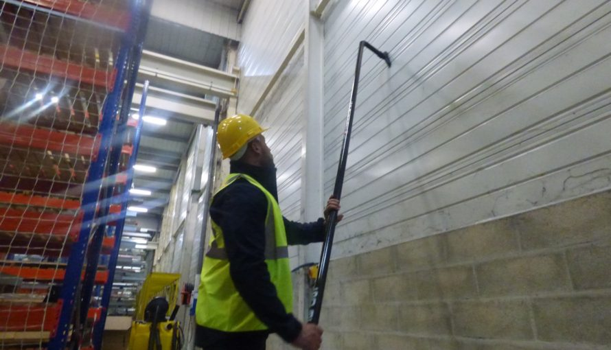 SpaceVac Industrial cleaning in a warehouse wall