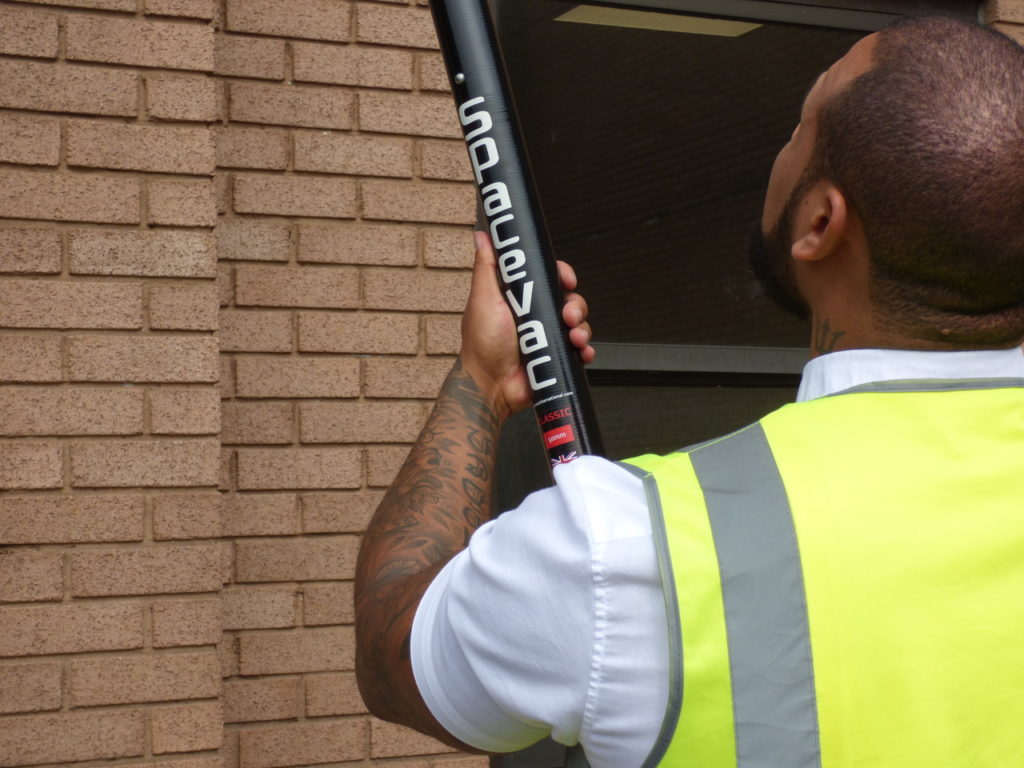 SpaceVac high reach gutter cleaning tool in action - image 9