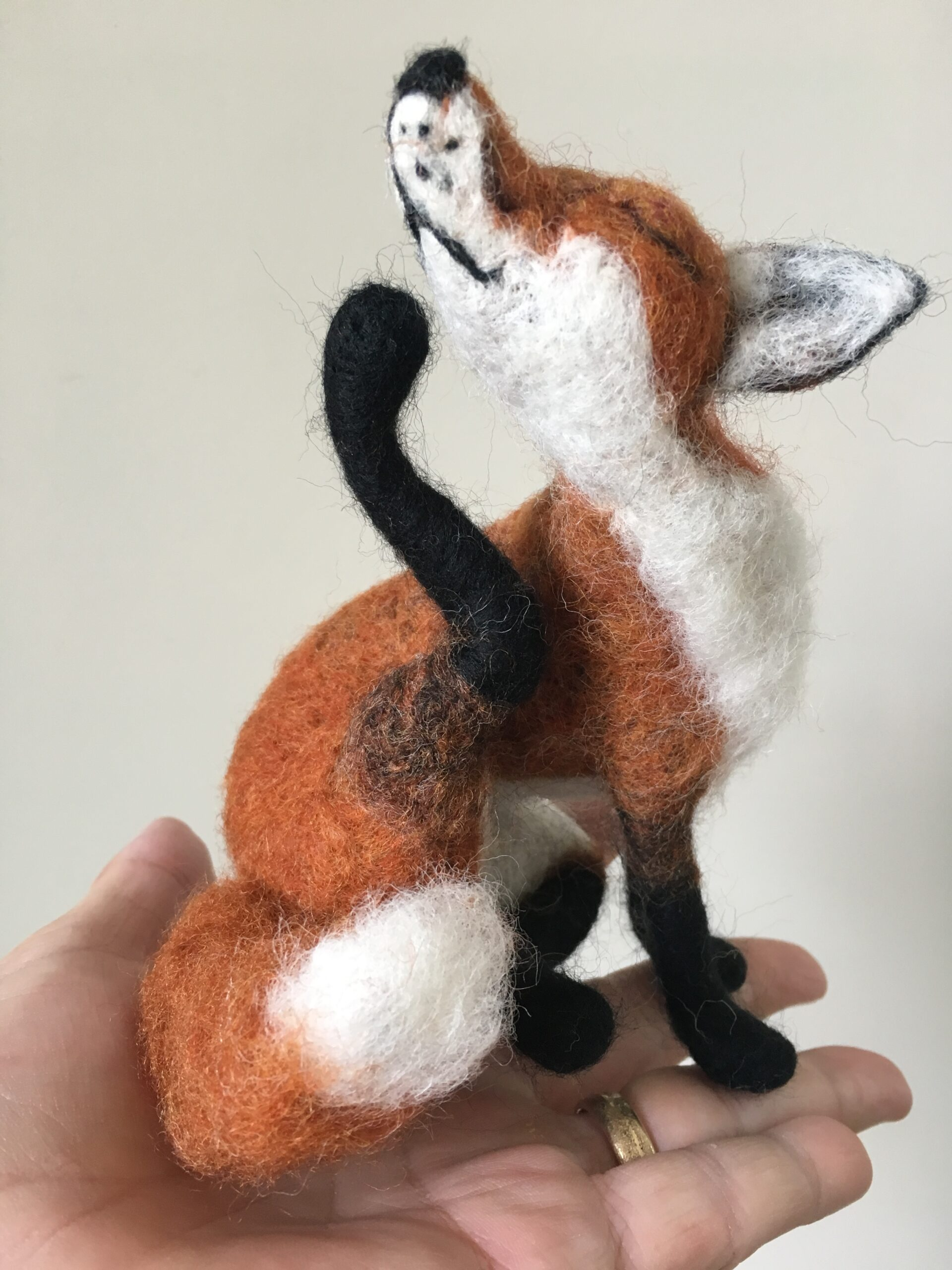 needle felted fox scratching his chin