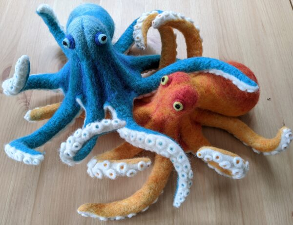 photo of an orange and blue needle felted octopus