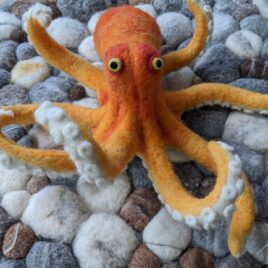 felted octopus with pebbles