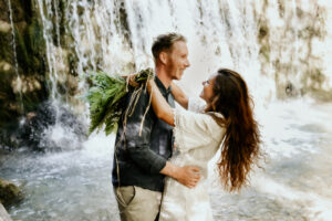boho relaxed elopement in front of a waterfall in the forest
