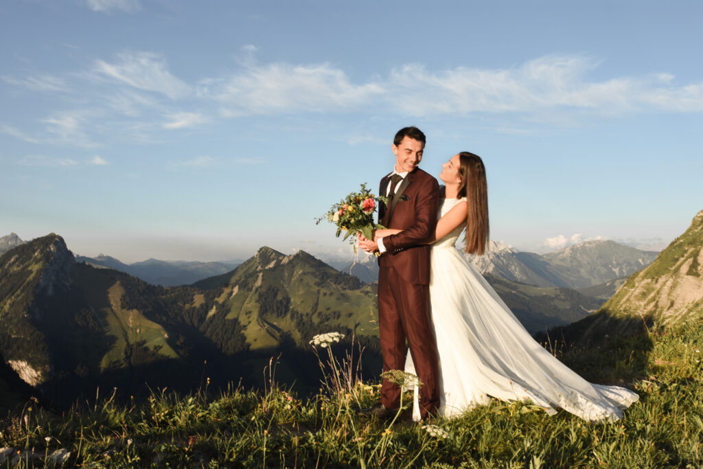 Young couple huging during their elopement in mountains in switzerland