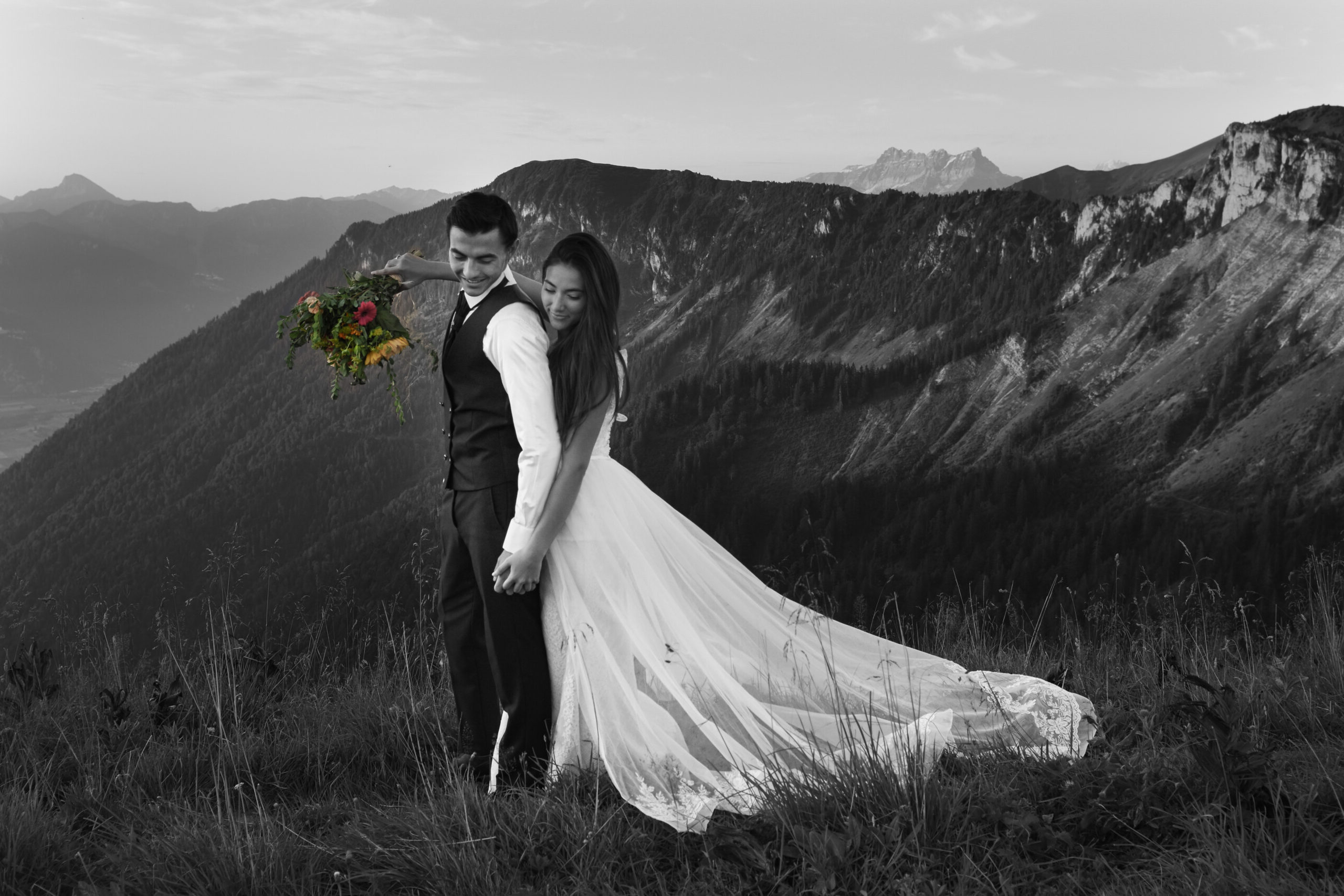 Bride surrounding arms around her groom during mountain elopement