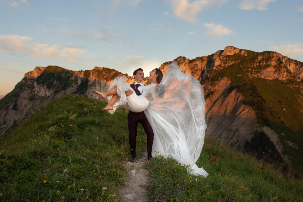 Bride and groom playing during their mountain elopement