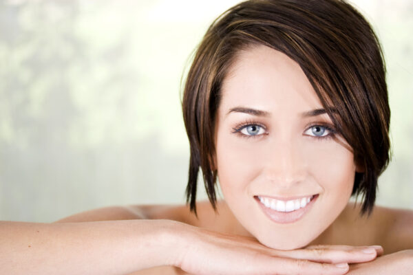 Beautiful woman with perfect skin, tropical application of essential oil, the positive change, Caledon Ontario