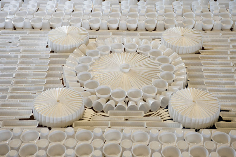 Plastic cups and cutlery make this carpet - Disposable Carpet - We Make Carpets