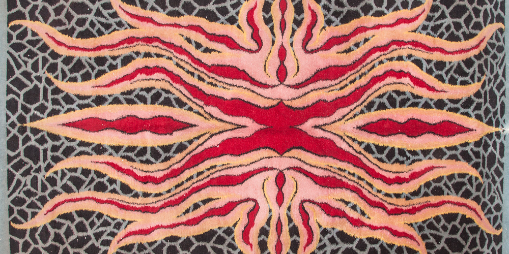 Detail of a rug with a psychedelic starfish pattern