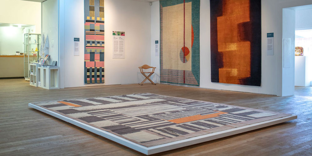 Installation shot of 'Under Your Feet' contemporary rugs on show at the Ruthin Craft Centre, north Wales, 6 April–14 July 2019.