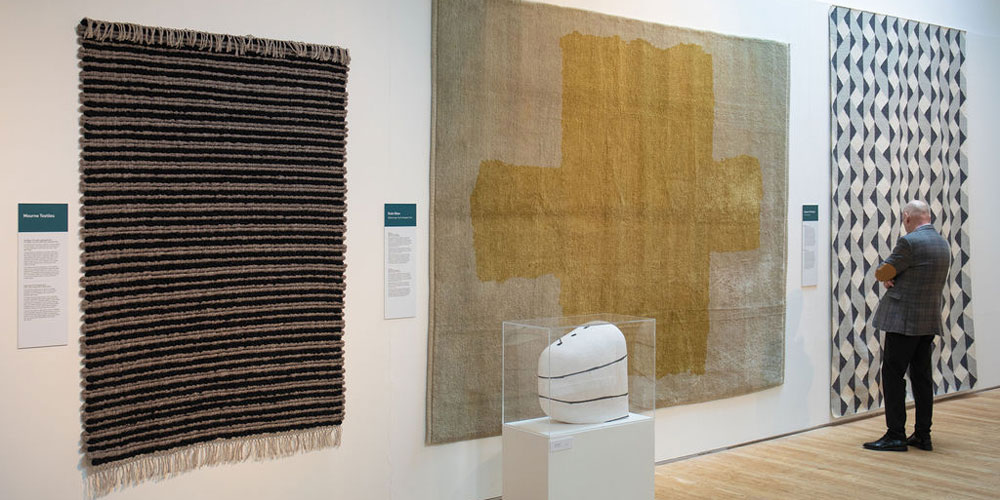 Installation shot of 'Under Your Feet' contemporary rugs on show atthe Ruthin Craft Centre, north Wales, 6 April–14 July 2019.