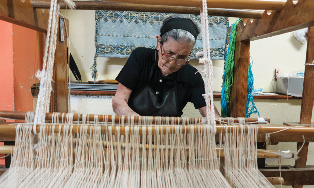 87-year-old Susanna Frongia, weaving at the Laboratorio Tessile Artigiano Isabella Frongia in Samugheo