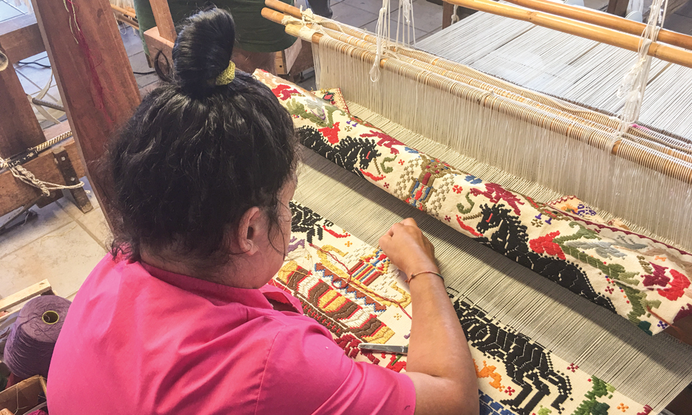 Weaver making bagas tapestry at the Su Trobasciu cooperative of weavers in Mogoro