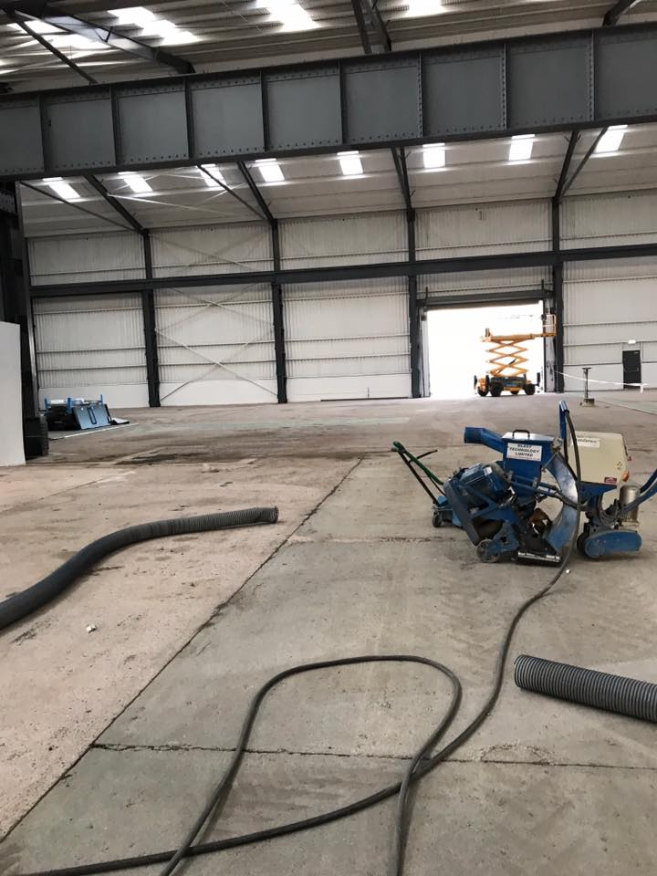 Removal of oil from concrete floor