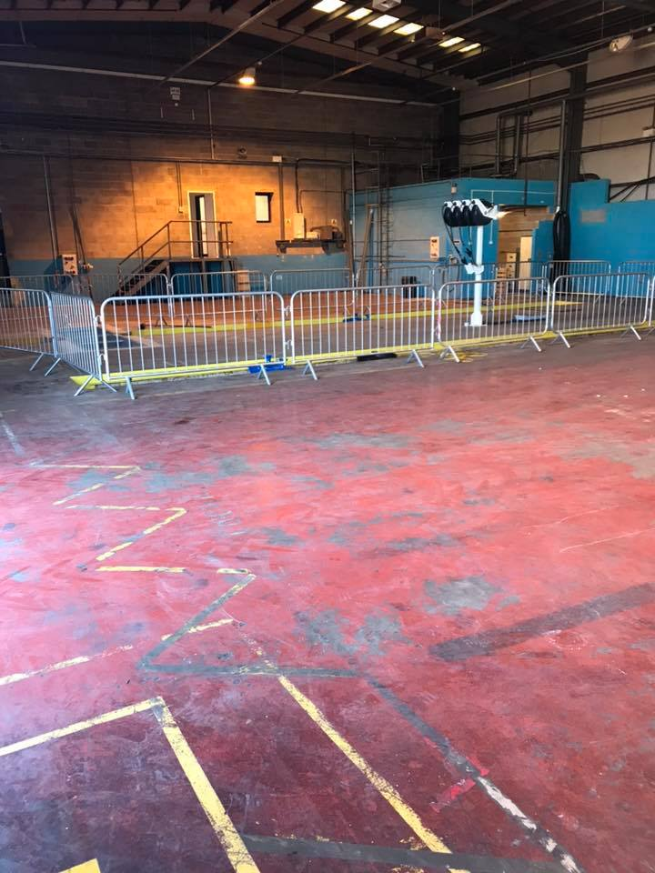 Failing floor paint removal at a workshop - before
