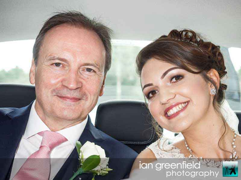 bride and father in wedding car,