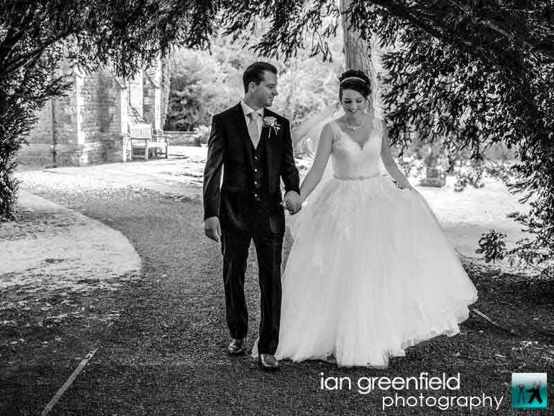 bride and groom walking, wedding photographer for Aldwark Manor, ian greenfield photography