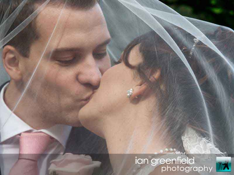 bride and groom kissing, wedding photographer for Aldwark Manor, ian greenfield photography