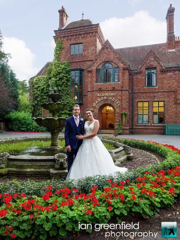 front view of flower beds, wedding photography at Aldwark Manor, ian greenfield photography,