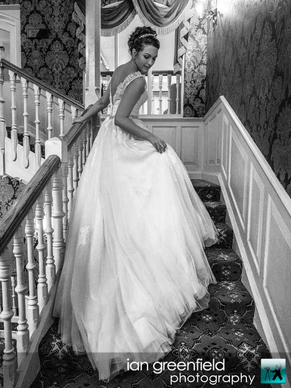 bride on the staircase, wedding photography at Aldwark Manor, ian greenfield photography,