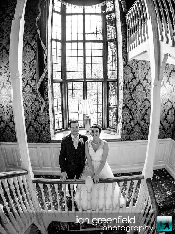 on the staircase, wedding photography at Aldwark Manor, ian greenfield photography,