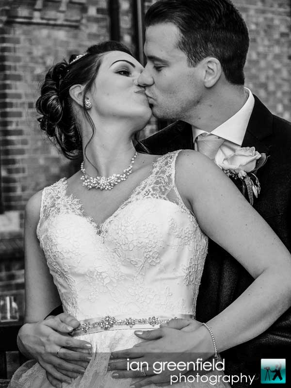 bride and groom kissing, North Yorkshire wedding photography at Aldwark Manor, Bride and groom wedding photographer, aldwark manor photographer, york, ian greenfield photography