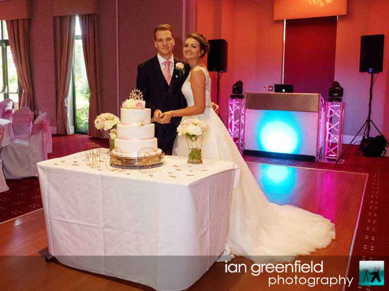 cutting the cake, Wedding Photographs taken at Aldwark Manor, Yorkshire professional wedding photographer, aldwark manor photographer, york, ian greenfield photography