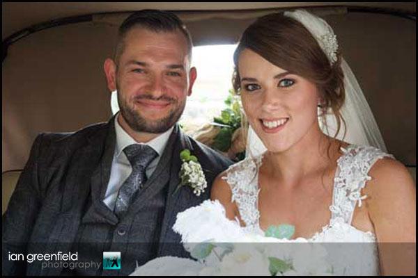 bride in wedding car_hirst priory wedding