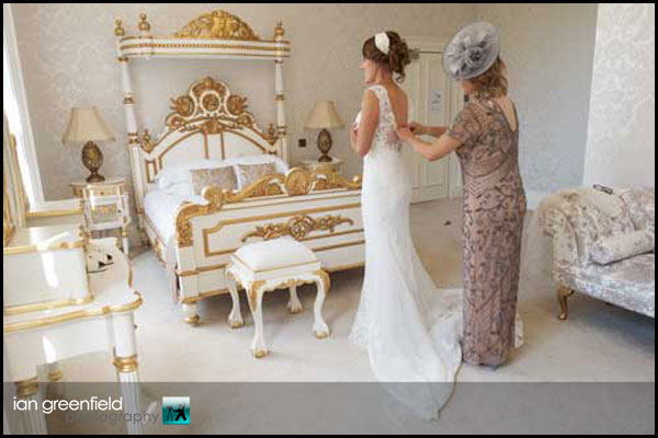 bride with mother getting ready hirst priory wedding