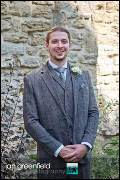 groom outside church hirst priory wedding