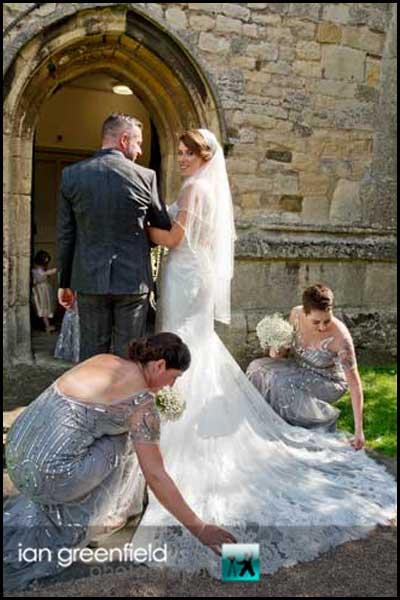bridesmaids helping bride hirst priory wedding