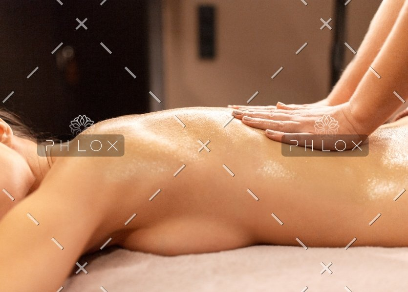 demo-attachment-1149-woman-lying-and-having-back-massage-at-spa-P9T7TEZ-2