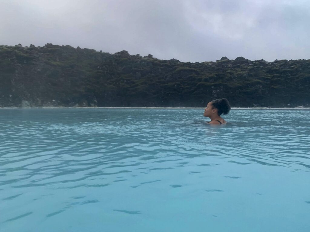 Imani swimming in the blue lagoon in Iceland, a great way to warm up in Iceland in winter.