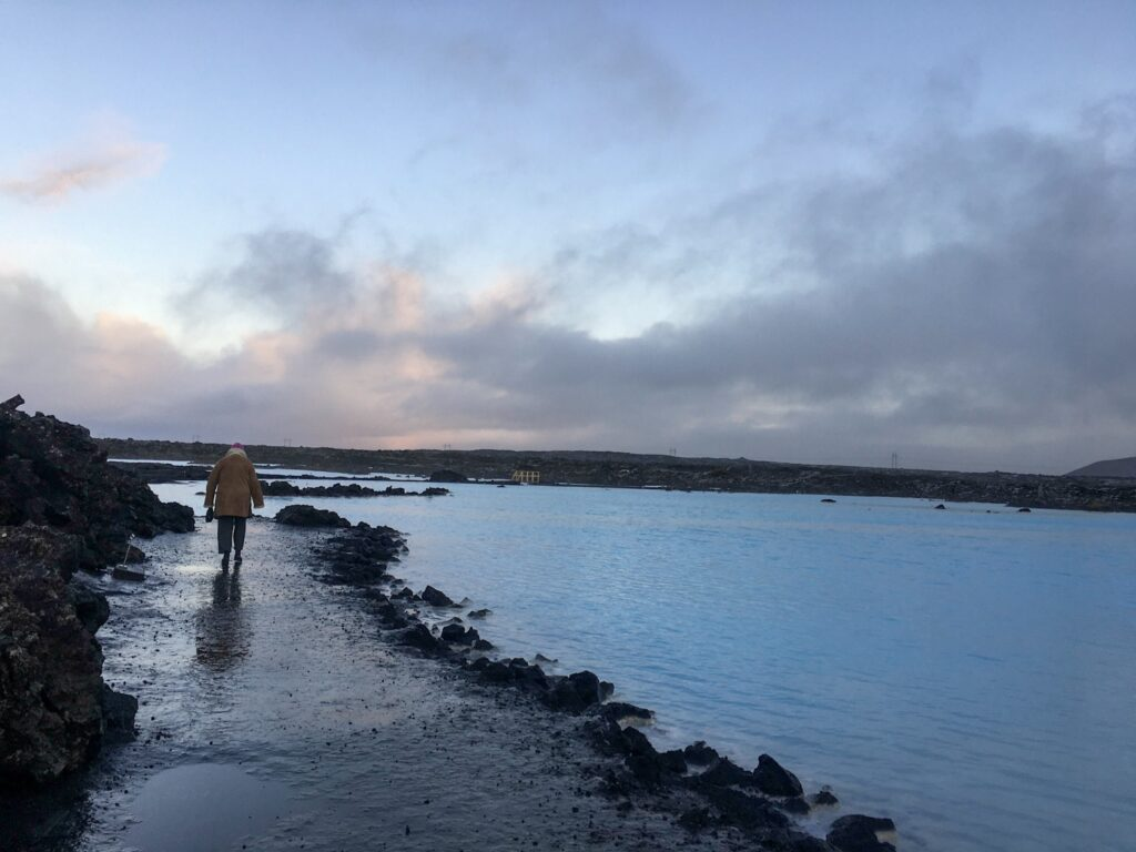 One person walking around the blue lagoon in Iceland in winter.