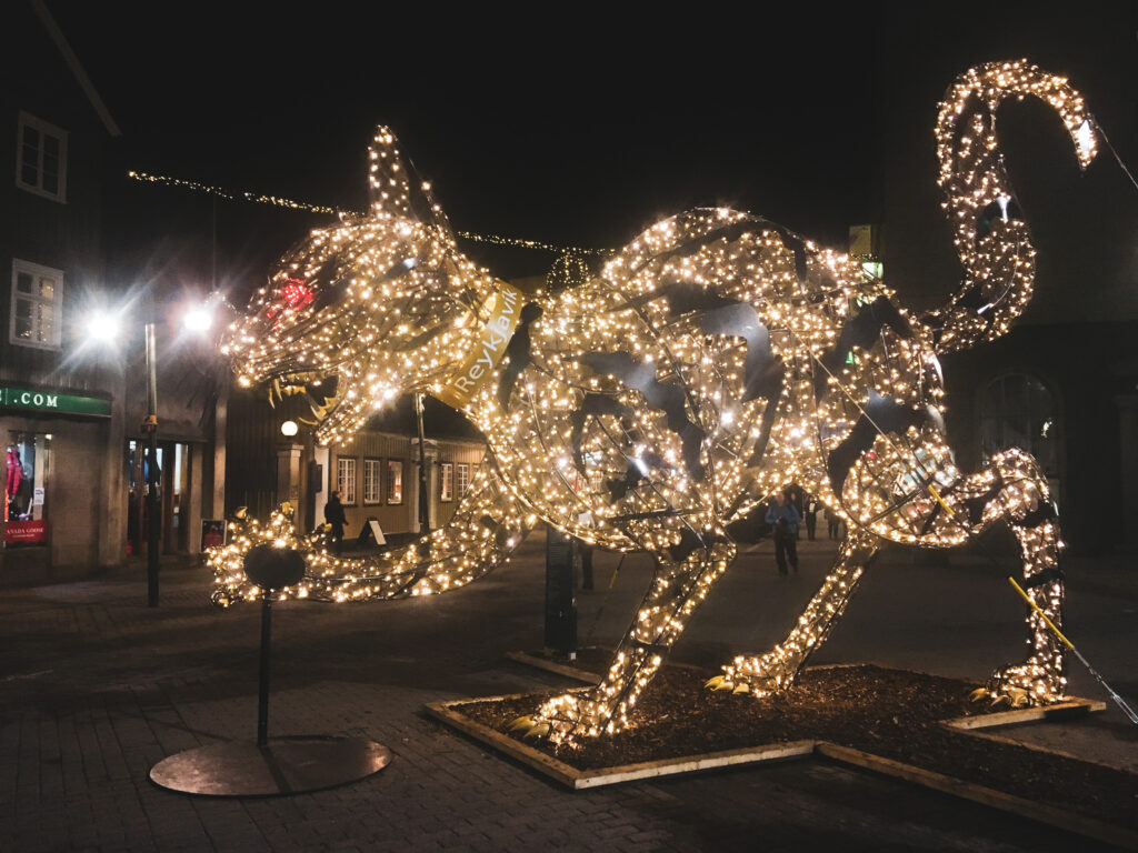 A Christmas lights display of the Yule cat in Reykjavik. Learning about Christmas folklore is one of the most fun things to do in Iceland in winter.