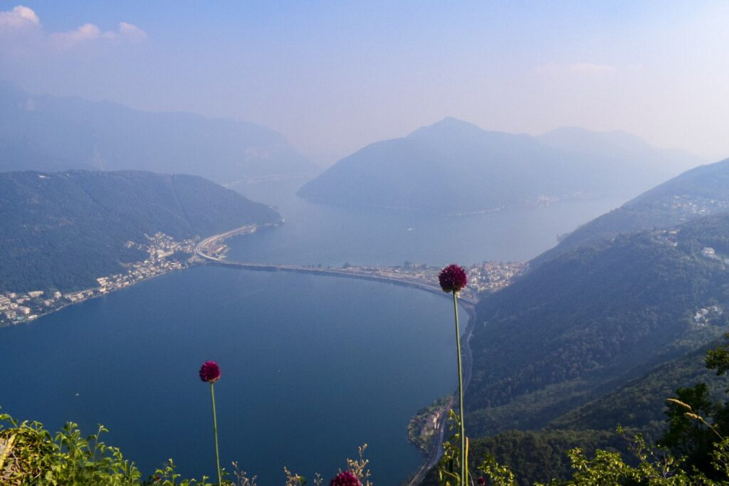The view from Monte San Salvatore in Lugano, with views of the lake and mountains that appear as though they're floating.