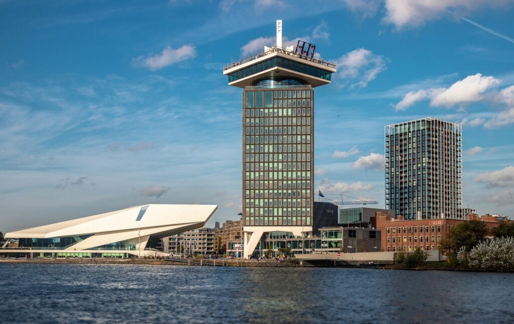 The Eye Film Museum and A'Dam Look Out Tower along the IJ River. Both of these sights are fun things to do in the evening in Amsterdam Noord.