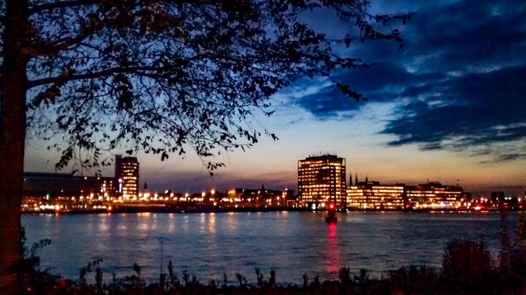 Amsterdam city skyline at night from Amsterdam Noord. Find out the best things to do in Amsterdam Noord in the evening.