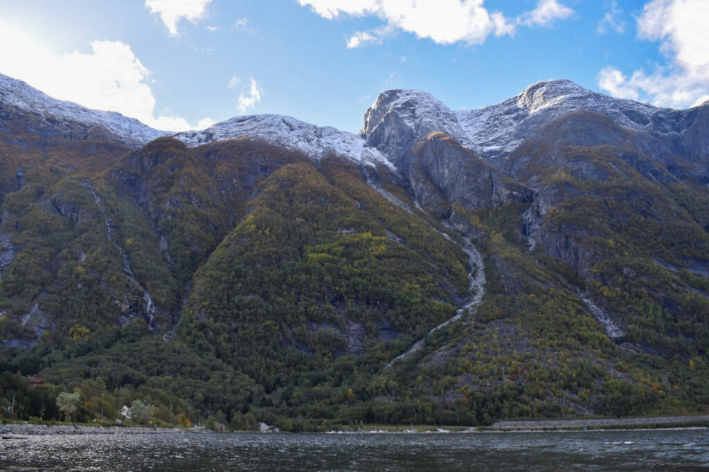 Snow capped mountain glacier in the Hardangerfjord.