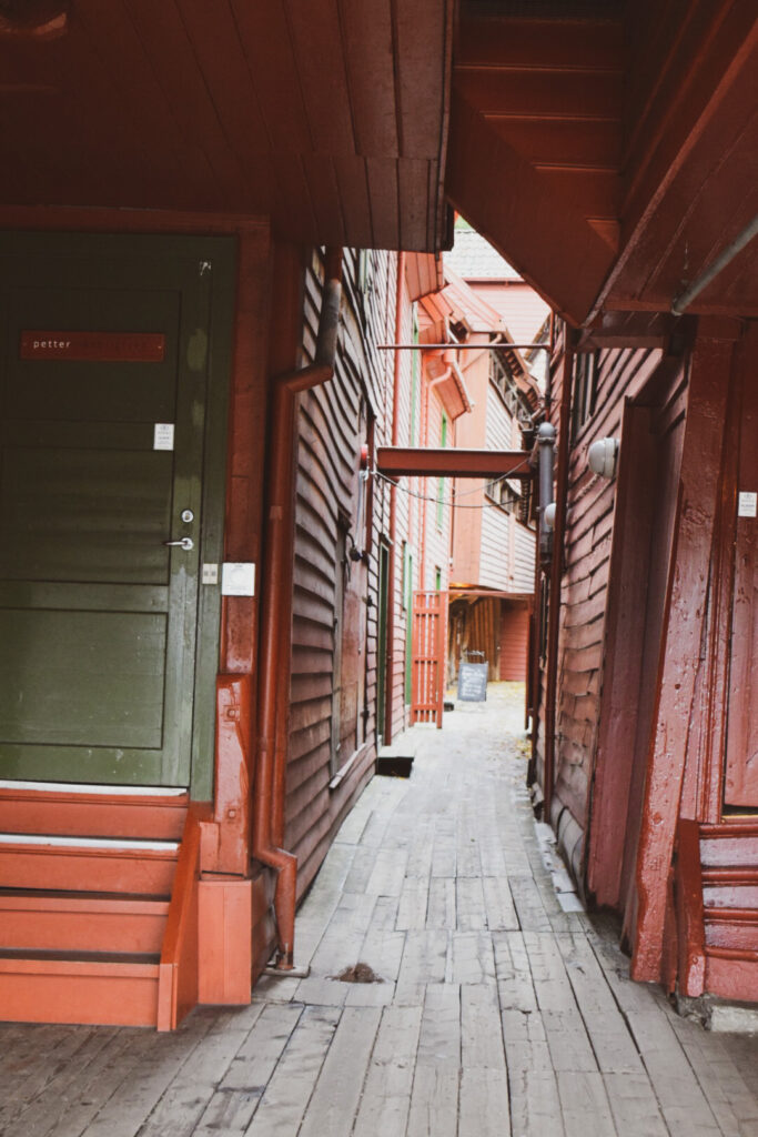 A corridor between two old wooden houses in Bergen's historic old town Bryggen. Spend a day in Bergen exploring the old town.