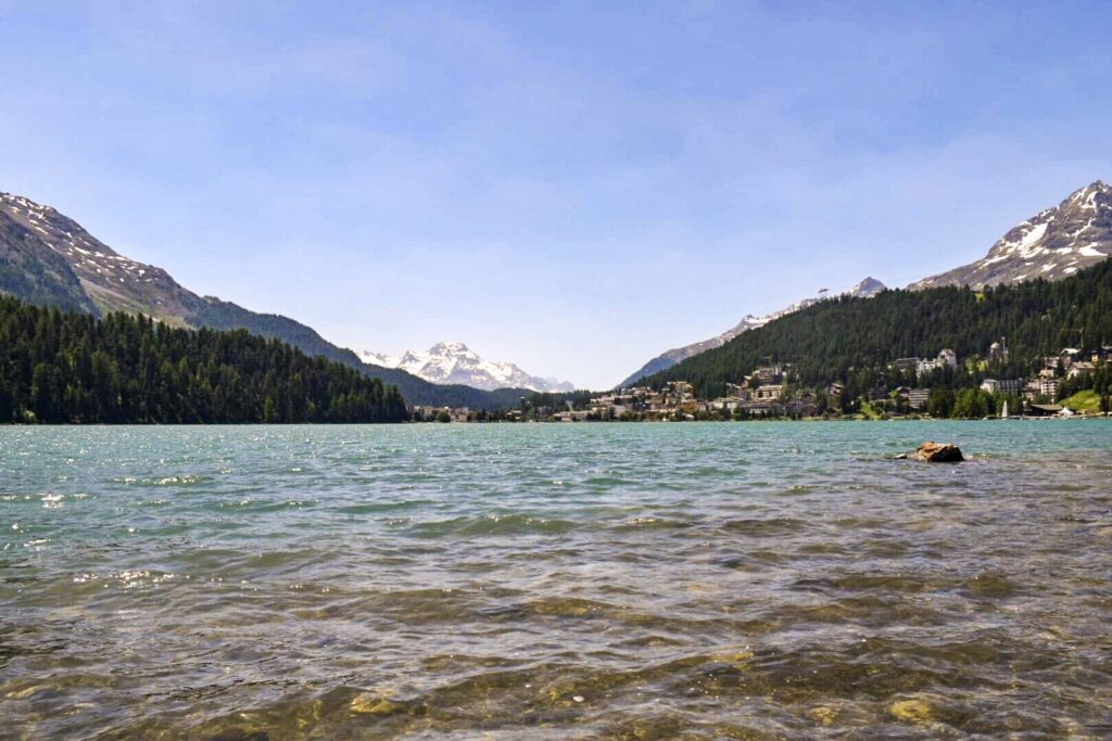 St Moritz lake is a beautiful spot nestled in the Swiss Alps surrounded by snow capped mountains, reachable in a day trip from Milan.