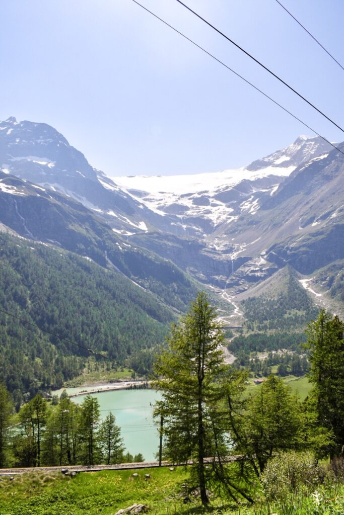 The Apline town of Alp Grum, a stop on the Bernina Express route, that can be done in a day trip from Milan.