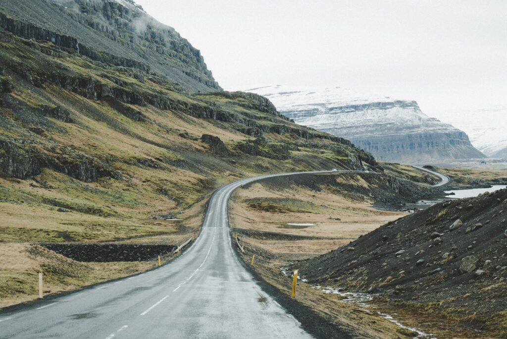 A stock photo of the Iceland ring road. Self driving is one way to travel Iceland on a budget.