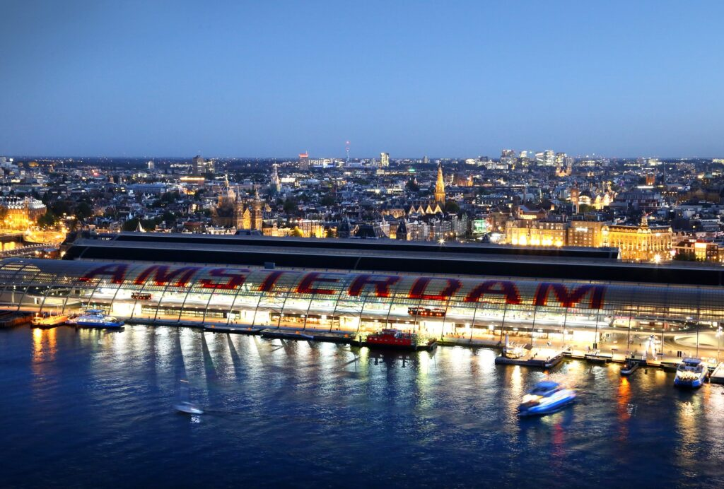 Amsterdam's Centraal Station shelter from above and views of the city skyline at night. The views from the A'Dam Tower are perfect for an evening in Amsterdam Noord.