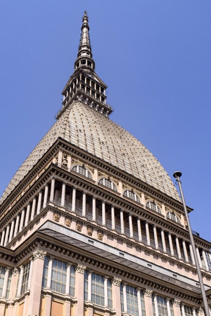 The Mole Antonelliana, a tall building with a pointy spire in Turin, Italy, which can be reached within an hour from Milan.