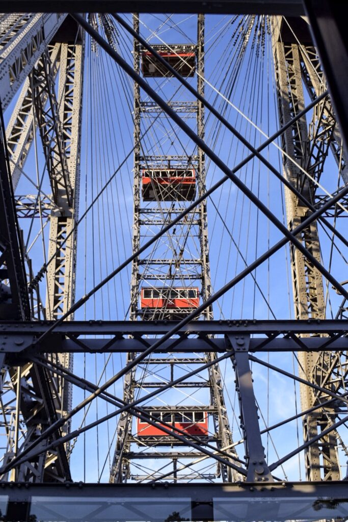 A view of the spokes inside the giant Viennese Ferris wheel in prater fun park from one of the carriages.